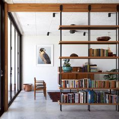 This single-storey house in Melbourne has been renovated by local studio Foomann to include exposed wooden beams that span the entirety of the property.
