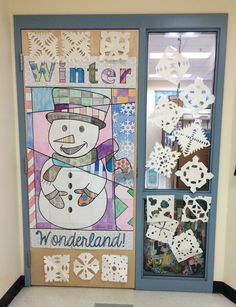 Winter snowman door decoration that all kids can participate in.