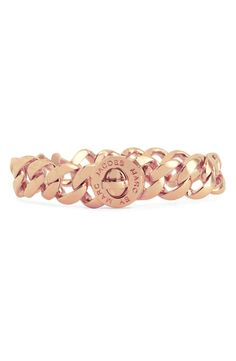 Adding this rose gold link bracelet to a stacked wrist | Marc Jacobs