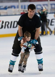 San Jose Sharks forward Patrick Marleau skates with his son during the family skate session at Levi's Stadium (Feb. 20, 2015).
