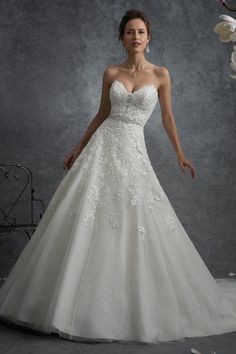 Wedding gown by Sophia Tolli for Mon Cheri.