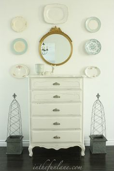 Beautiful refinished piece and love the antique plates on wall