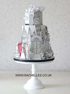 Love this modern yet whimsical version of a city skyscraper cake
