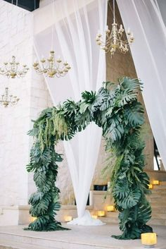 Tropical Palm Frond Floral Arch #floralarch #weddingceremony