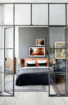 coco-republic_fieldnotes_Loren Gauthier | off centred art on wall above bed | white euro pillows + small black velvet cushions