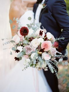 Dahlia, garden rose and rose wedding bouquet: Photography : Rachel Solomon Photography | Event Planning : Ashley Gain Weddings and Events | Floral Design : Carte Blanche Design | Gown : Vera Wang | Groom's Attire : Burberry | Reception Venue : Sanctuary on Camelback Read More on SMP: http://www.stylemepretty.com/arizona-weddings/paradise-valley/2017/01/16/desert-sunset-wedding/