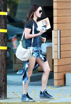 Studying up? Megan was spotted toting a book on palm reading as she left the salon on Sund...