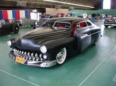 Satin Beauty with red leather interior, DeSoto 11-tooth grill, Coker wide whites, suicide coupe. Gorgeous.