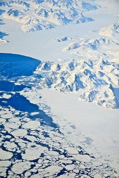 This was the view from the plane between Greenland and north of Canada.  Icebergs everywhere