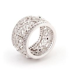 This rhodium plated statement band is accented with a classic detailed filigree design, adorned with 1.5ct of clear CZ.