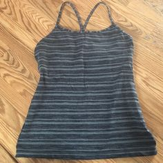Lululemon gym tank - Med or large. I've had this for a while but I took the tags out of it so I'm not sure if it's a medium or large... But it fits both medium and large. Built in bra with padding that you can keep in or take out. Very cute top! lululemon athletica Tops