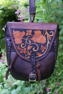 versatile small rucksack / shoulder bag with cunning straps and foliate carving. http://www.skyravenwolf.com/index.php