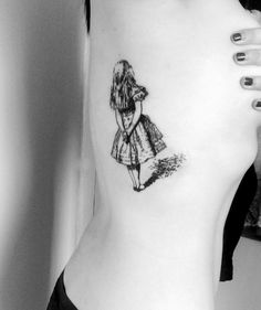 Alice in wonderland tattoo - Hell to Pay tattoo & piercing Camden high St, London