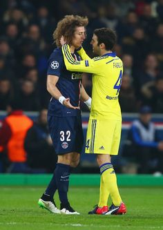 Cesc Fabregas of Chelsea and David Luiz of Paris Saint-Germain in discussion during the UEFA Champions League Round of 16 match between Paris Saint-Germain and Chelsea at Parc des Princes on February 17, 2015 in Paris, France.
