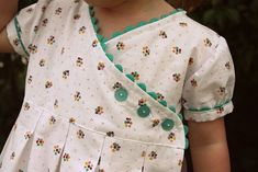 detailed tutorial for a DARLING child's dress...perfect for vintage fabrics and using ric-rac!