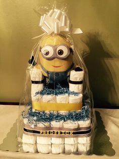 Minion diaper cake! Minion Dave for baby Frederick :) 3 Tiers. Size 2 diapers.- Don't forget Yellow and Blue personalized napkins to match your theme! #minion #party www.napkinspersonalized.com