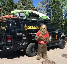 Love this pic!  Gerber Gear van with Aluminess bumpers, roof rack and ladder...and Big Foot...