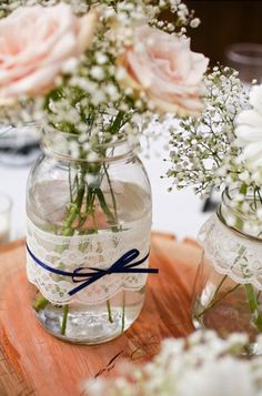 Simple casual centerpiece-Roses and baby's breath in a jar decorated with lace and ribbon.