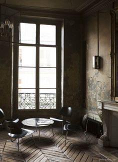 Parisian studio, herringbone floors, lantern, French doors / Garance Doré