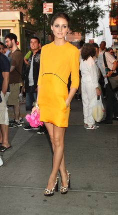 Olivia Palermo with yellow dress, pink clutch and leopard heelos
