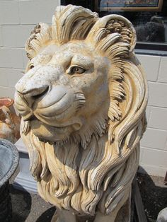I found this sweetheart at an antique store in New Jersey. At over 4 foot tall and $1500 for a pair, this Lion just isn't in my future.