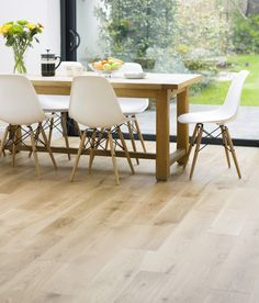 Light and natural oak for a classic yet modern finish. I also love the chairs. Easy to maintain. Very affordable knock offs. :)