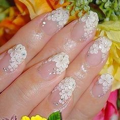 100 Delicate wedding nail ideas. Like these amazing floral wedding nails.
