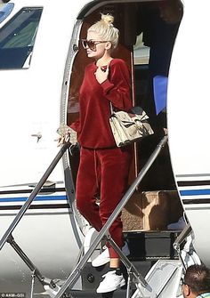 Kylie Jenner is a fashionable flyer in red velour jumpsuit as she takes private…
