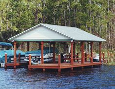 Large gable roof covering boat slip and deck