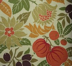 Copacabana Fabric Fruit and leaf printed cotton fabric in russet, oche, green and beige