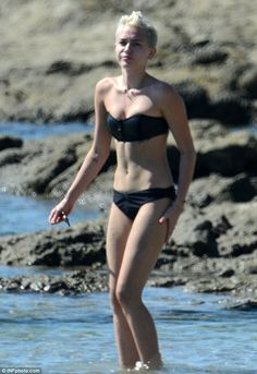 cbb8e63a3ab Fitness fanatic Miley Cyrus shows off her incredible bikini body as she  'gives thanks for her blessings' in Costa Rica