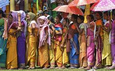 Bodo tribal people wait in queue to cast their votes during the 3rd Bodoland Territorial Area District (BTAD) elections in Baksa district of Assam state, India. Thousands of people are eligible to vote in 2,778 polling stations in the four BTAD districts of Assam. A total of 315 candidates are contesting in the 40 constituencies spread over four districts of BTAD.