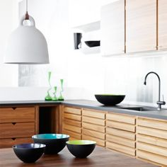 The wood cabinets are homey and chic, could do this. Normann Copenhagen: Bell lamp