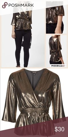 NWT Topshop top Kick up the shimmer in a flattering crossover top.Size US4 fits 0-2 Hidden side-zip closure. 100% polyester. Topshop Tops