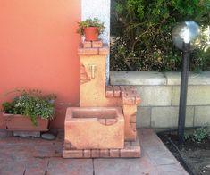 Fontanella da giardino modello Fonte del casale, colore: mattone. Località: Torpé (Nuoro).