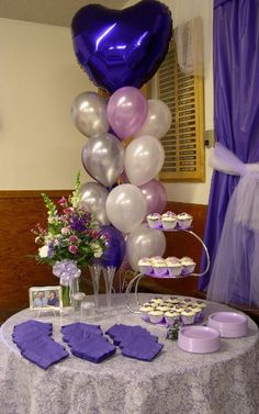 Elegant balloon centerpiece for a cake table. The light purple, cream and silver goes very well with the bright blue mylar heart on top. Wedding Balloon Decorations, Cake Table Decorations, Balloon Centerpieces, Wedding Balloons, Bridal Shower Decorations, Balloon Tree, Balloon Bouquet, Balloon Ideas, Purple Balloons