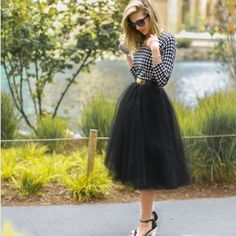 Black tulle skirt Super chic and pretty. Fluffy and comfy, no itchy. Elastic waist band. S: waist 24 inches can be stretched 41 inches. M: 26 inches can be stretched to 43, L: 27 can be stretched to 45 inches. XL: 28 can be stretched to 47 inches. NWOT. Three layers in total Skirts Midi