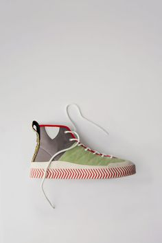 Acne Studios Blå Konst Conny multi pistachio are colour blocked high top sneakers.