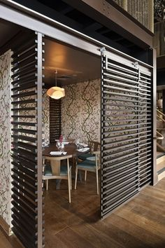 Luchetti Krelle  Timber screens delineate private dining areas.