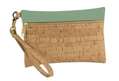 This wristlet zip pouch is the perfect accessory! Handmade from eco-friendly cork. Read more about The Green Story. Cork fabric Organic cotton lining Eco-friendly + PVC-free faux leather Removable wristlet strap Zipper closure Gold Hardware x Large: x Cork Fabric, Vinyl Fabric, Purse Wallet, Diy Purse, Handbag Accessories, Bag Making, Purses And Bags, Gold Hardware, Organic Cotton