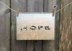 Beach Theme Photo- Hope, optimistic word art, coastal decor. Hope Beach Theme Photo- At this time in our troubled world, HOPE is a great sentiment to pass on to others. I created my HOPE Beach Wish on a perfect, early summer day on the beach near my home in Plymouth, Massachusetts. I walked the shore line looking for just the right beach stones to create this Beach Wish. Hope will make a wonderful gift for those who wish to express optimism for the future. My beach themed photo works well…