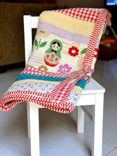 have to love gingham and stripes and florals and matryoshka dolls all on one quilt