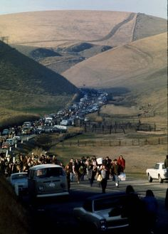 Summer of 1969 , Woodstock Festival  i love these rolling hills. and all those vw buses. ahh!