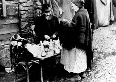 Kutno, Poland, Early 1941, A Jewish peddler in a ghetto street.