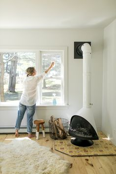 5 places to clean this spring in your home you may not think about. Get all the places on The Fresh Exchange. Fireplace Bookshelves, Home Fireplace, Living Room With Fireplace, Fireplace Design, Fireplaces, Freestanding Fireplace, Casa Real, Loft, Outdoor Rooms
