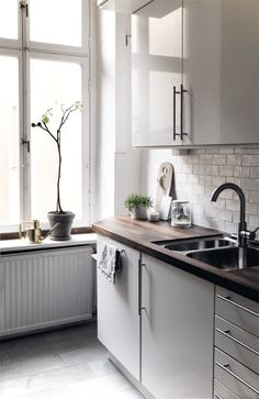 Love this feel for the kitchen, dark woods on grays on white.
