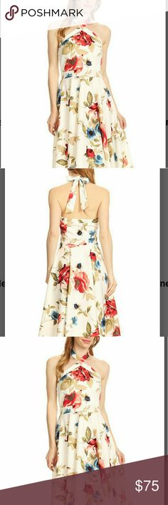 COMING SOON! (M, L XL) Flirty Floral Halter Dress A breezy feminine dress with a flattering fit to accentuate your shoulders.  Perfect spring and summer dress.  37in long.  96%poly, 4%spandex.  Made in the USA.  more pics to come... Dresses