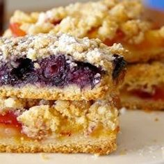In these easy bar cookies, blueberries top a pastry crust and get sprinkled with a cinnamon crumble before baking. You can use any berries you like.