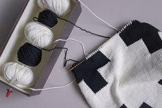 Brilliant. The intarsia box (long needle or straw as a spindle, held on point end with a point protecter) keeps your many little balls of yarn in a neat line while you work. Much more portable, too!