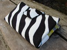 Make a wallet clutch from free upholstery scraps and swatch books. Free tutorial on how to make these!